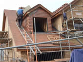 New-build house using Dreadnought clay plain tiles, during construction.